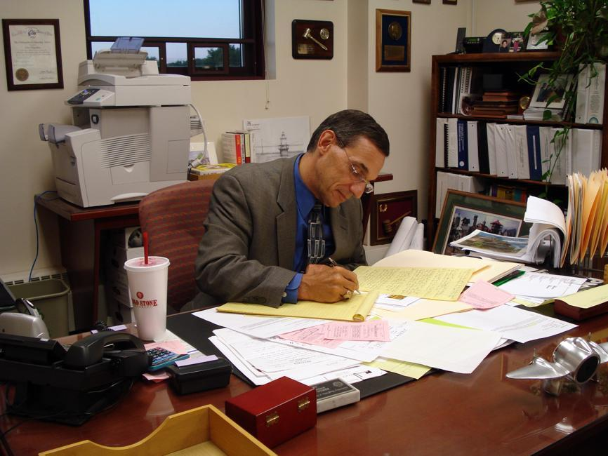 In 2009, Mansfield did not renew John D'Agostino's contract as town manager but paid his salary in full .